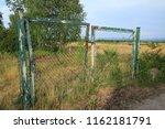 old rusty garden gate  door  on ... | Shutterstock . vector #1162181791