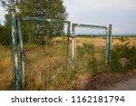 old rusty garden gate  door  on ... | Shutterstock . vector #1162181794