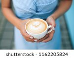 woman with manicure holding cup ... | Shutterstock . vector #1162205824