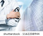 young man doctor holding... | Shutterstock . vector #1162208944