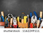 tool belt with tools on wooden... | Shutterstock . vector #1162249111