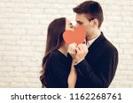 happy couple with red heart...   Shutterstock . vector #1162268761