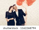 happy couple posing with...   Shutterstock . vector #1162268794