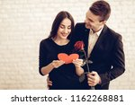 couple with rose and red heart...   Shutterstock . vector #1162268881