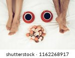 happy couple are lying in bed...   Shutterstock . vector #1162268917