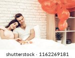happy couple are lying in bed...   Shutterstock . vector #1162269181