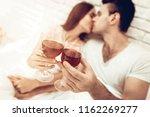 beautiful couple wine drinking...   Shutterstock . vector #1162269277