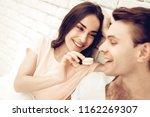 guy feeds girlfriend with sweet....   Shutterstock . vector #1162269307