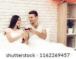 beautiful couple wine drinking...   Shutterstock . vector #1162269457