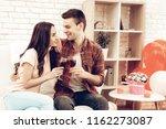 beautiful couple wine drinking...   Shutterstock . vector #1162273087
