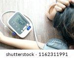 woman check blood pressure... | Shutterstock . vector #1162311991