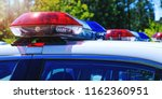 Small photo of Patrol police car with beautiful emergency sirens lights. Canadian policemen in traffic control activity. A police raid for arrest and stop of crime delinquents. Flashing light on security cars.