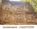 Old Stucco Buddha And Angel...