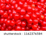 lots of cherry berries close up....   Shutterstock . vector #1162376584