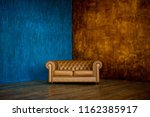 brown sofa chester on a... | Shutterstock . vector #1162385917