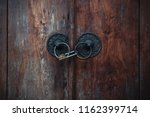 rusty padlock on an antique... | Shutterstock . vector #1162399714