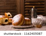 traditional round donuts with a ... | Shutterstock . vector #1162405087