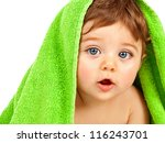 Stock photo image of cute baby boy covered with green towel isolated on white background closeup portrait of 116243701