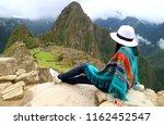 young female traveler admiring...   Shutterstock . vector #1162452547