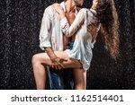 partial view of seductive wet... | Shutterstock . vector #1162514401