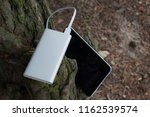 a portable charger charges the... | Shutterstock . vector #1162539574