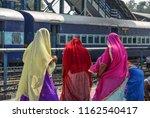 local women waiting at railway... | Shutterstock . vector #1162540417