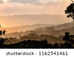 Small photo of Foothills of Monteverde, Santa Elena in Costa Rica highlands. Panoramic view in beautiful orange sunset day of a vast hills and mountains in this pristine region of Central America