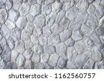 gray stone wall texture... | Shutterstock . vector #1162560757