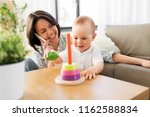 family  child and motherhood... | Shutterstock . vector #1162588834