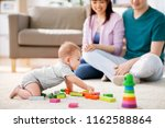 family  parenthood and people... | Shutterstock . vector #1162588864