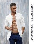 handsome man in white shirt... | Shutterstock . vector #1162618354