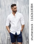 handsome male model wear white... | Shutterstock . vector #1162618384