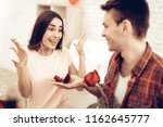 a guy gives a ring to...   Shutterstock . vector #1162645777