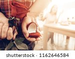 guy gives a ring to girlfriend...   Shutterstock . vector #1162646584