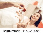guy makes a gift to girlfriend...   Shutterstock . vector #1162648054