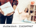 guy makes a gift to girlfriend...   Shutterstock . vector #1162649467