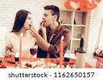 cheerful couple romantic dinner ...   Shutterstock . vector #1162650157