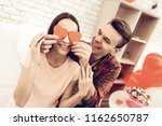 couple holding red heart...   Shutterstock . vector #1162650787