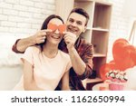 couple holding red heart...   Shutterstock . vector #1162650994