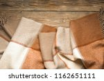 warm wool blanket thrown on... | Shutterstock . vector #1162651111