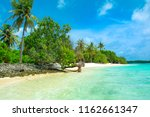 beautiful sandy beach in... | Shutterstock . vector #1162661347