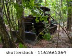 old crawler tractor in the... | Shutterstock . vector #1162665364
