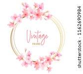 watercolor cherry blossom frame | Shutterstock .eps vector #1162690984