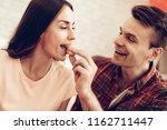 guy feeds girlfriend with sweet....   Shutterstock . vector #1162711447