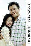 asian father and daughter are... | Shutterstock . vector #1162719031