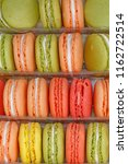 close up of color macaroons on... | Shutterstock . vector #1162722514