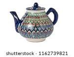ceramic teapot isolated on white   Shutterstock . vector #1162739821