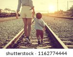 toddler girl holding hands with ... | Shutterstock . vector #1162774444
