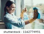young smiling woman washing... | Shutterstock . vector #1162774951