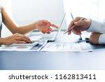 asian business adviser meeting... | Shutterstock . vector #1162813411